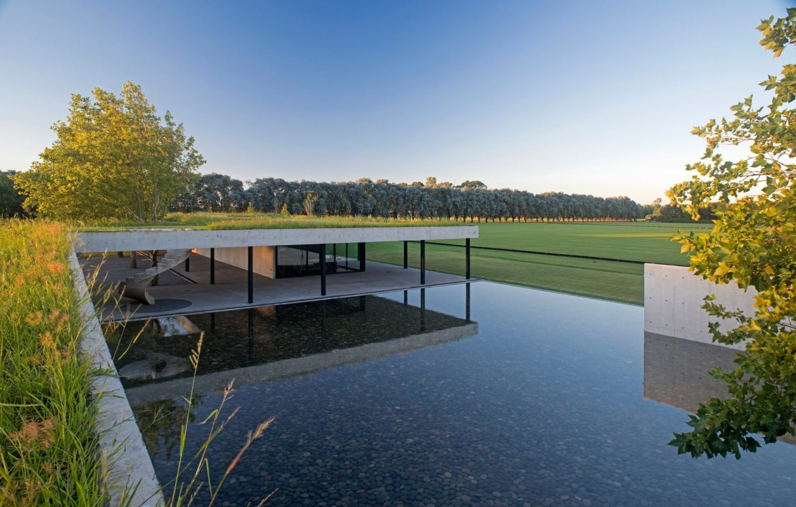 Luxury Villa, Grazing Horses, Nacho Figueras, top house, architect, building, billionaire, horse, garden, roof, Ramos studio, youtube, video, Polo Stables, Argentina, Buenos Aires, living room, storage room, saddles, boots, helmets, spiral staircase, pool, panorama, Juan Ignacio Ramos, peace, calm, relax, wine,
